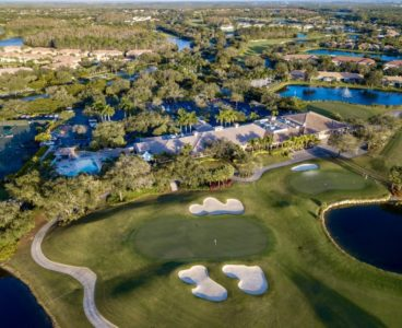 aerial view of country club golf course and lake