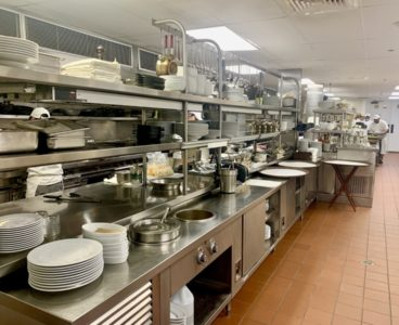 fully stocked kitchen with plates and pans