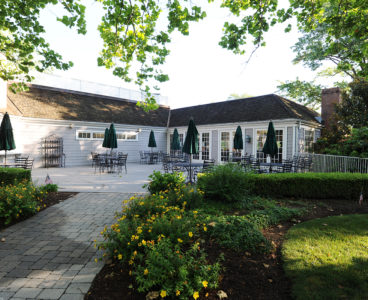 outdoor back view of country club and patio