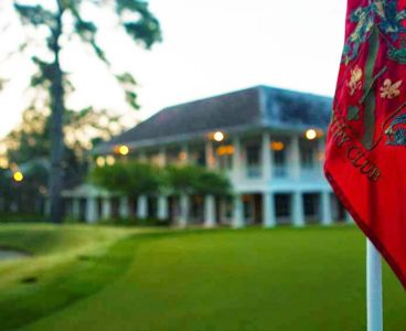 outdoor view of country club on golf course red flag