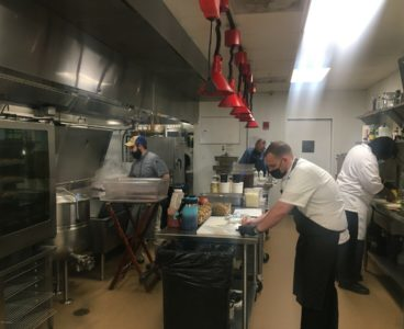 chefs in back of house kitchen